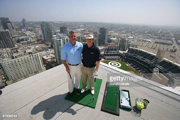 Player Briny Baird and Padres GM Kevin Towers pose for a photo before hitting off the roof of the Omni Hotel attempting to land a golf ball on a...