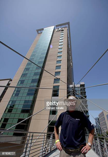 Player Briny Baird stands in front of the Omni Hotel after hitting off the roof of the Hotel attempting to land a golf ball on a bullseye planted in...