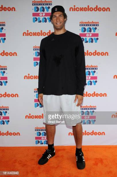"NBA player Brook Lopez walks the ""orange"" carpet for the 10th Annual Worldwide Day of Play at Prospect Park on September 21 2013 in New York City"