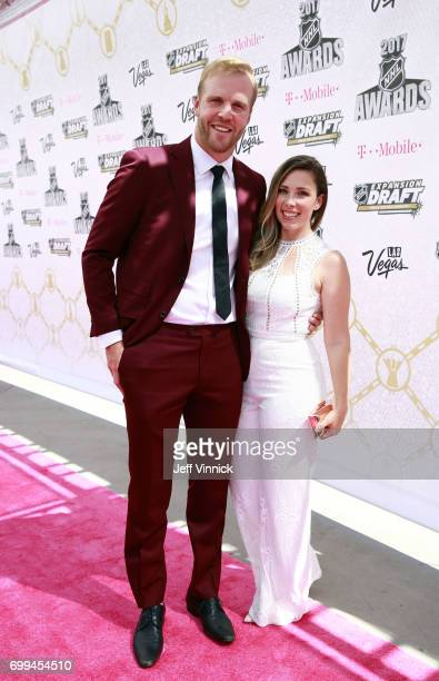 NHL player Bryan Bickell and wife Amanda arrive on the magenta carpet for the 2017 NHL Awards at TMobile Arena on June 21 2017 in Las Vegas Nevada