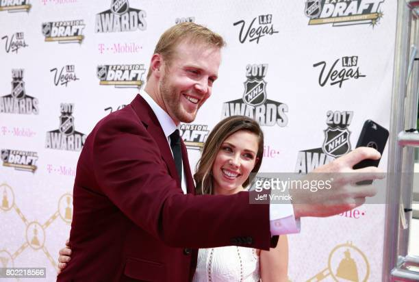 NHL player Bryan Bickell and wife Amanda take a selfie photo on the magenta carpet for the 2017 NHL Awards at TMobile Arena on June 21 2017 in Las...