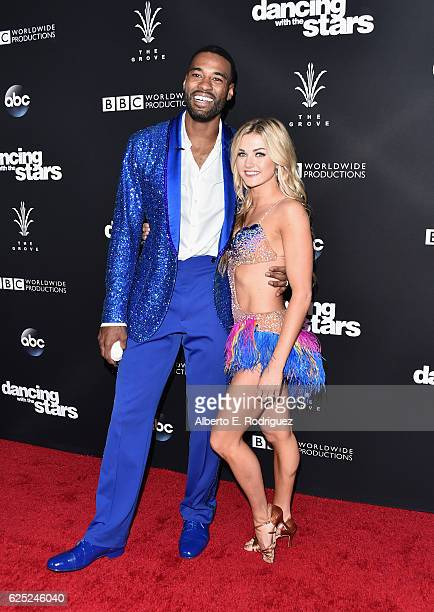 NFL player Calvin Johnson and professional dancer Lindsay Arnold attend ABC's Dancing With The Stars Season 23 Finale at The Grove on November 22...