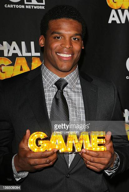NFL player Cam Newton poses in the press room during the 2nd Annual Cartoon Network Hall of Game Awards at Barker Hangar on February 18 2012 in Santa...