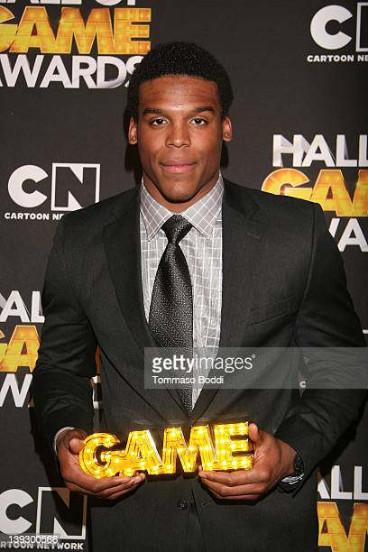 NFL player Cam Newton poses in the press room during the Cartoon Network's Hall Of Game Awards at Barker Hangar on February 18 2012 in Santa Monica...