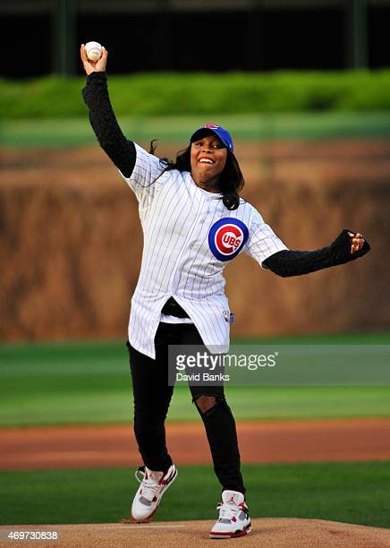 WNBA player Cappie Pondexter throws out the first pitch before the game between the Chicago Cubs and the Cincinnati Reds on April 14 2015 at Wrigley...