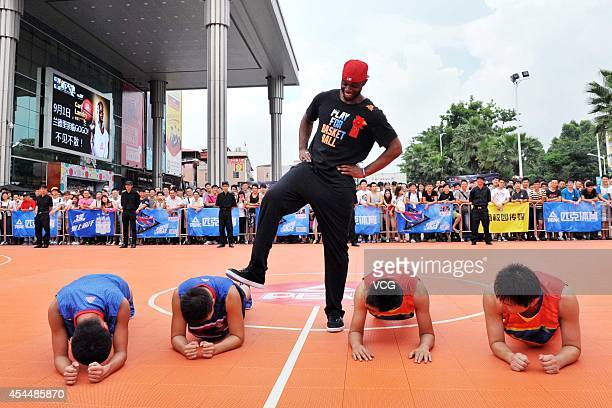 NBA player Carl Landry of the Sacramento Kings interacts with fans during a fan meeting at Guangzhou Higher Education Mega Center on September 1 2014...