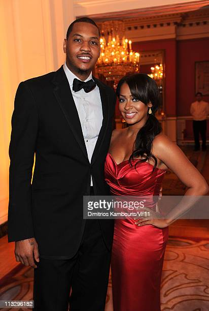 NBA player Carmelo Anthony of the New York Knicks and TV personality Lala Vasquez attend the Bloomberg Vanity Fair cocktail reception following the...