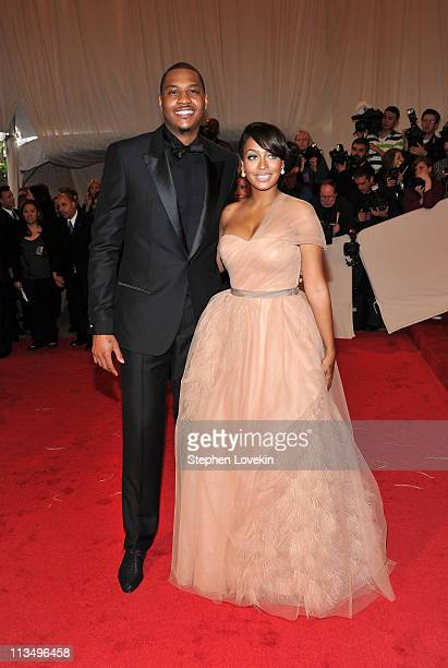 NBA player Carmelo Anthony of the New York Knicks and TV personality Lala Vasquez attend the 'Alexander McQueen Savage Beauty' Costume Institute Gala...