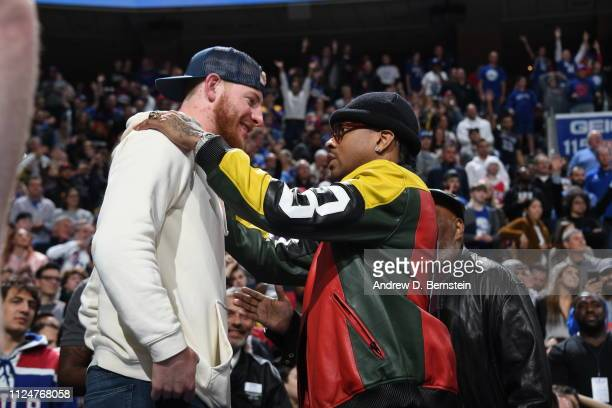 NFL player Carson Wentz and NBA legend Allen Iverson talk during the game between the Los Angeles Lakers and the Philadelphia 76ers on February 10...