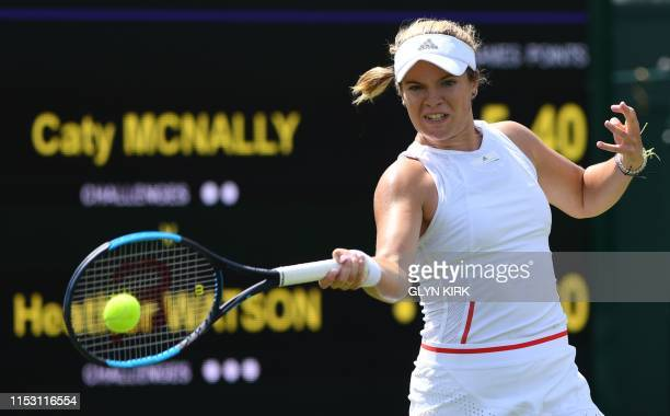 US player Cate McNally returns against Britain's Heather Watson during their women's singles first round match on the first day of the 2019 Wimbledon...