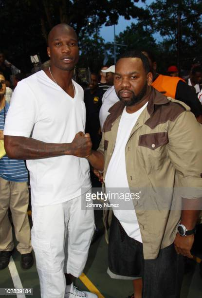 NFL player Chad Ochocinco and recording artist Raekwon attend the Entertainers Basketball Classic at Rucker Park on July 12 2010 in New York City