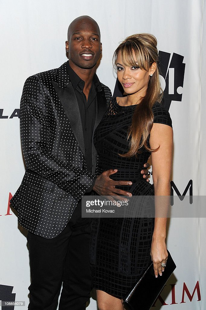 NFL player Chad Ochocinco Johnson and Evelyn Lozada poses with AOL at the Maxim Party Powered by Motorola Xoom at Centennial Hall at Fair Park on February 5, 2011 in Dallas, Texas.