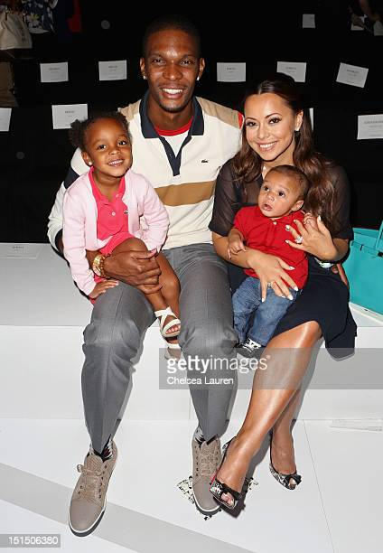 Player Chris Bosh Adrienne Williams Bosh and children attend the Lacoste Spring 2013 fashion show during MercedesBenz Fashion Week at The Theatre...
