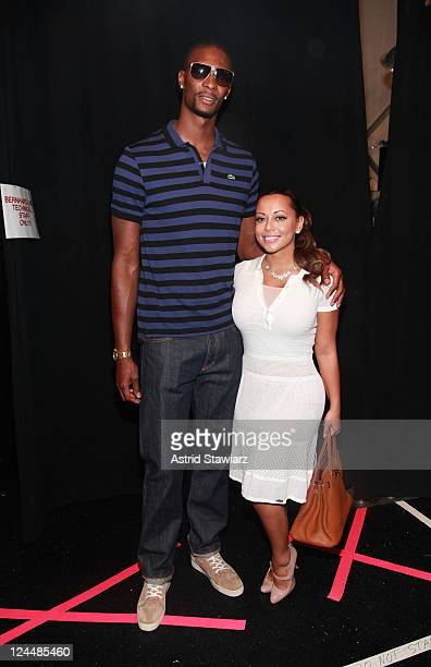 NBA player Chris Bosh and wife Adrienne Williams pose backstage at the Lacoste Spring 2012 fashion show during MercedesBenz Fashion Week at The...