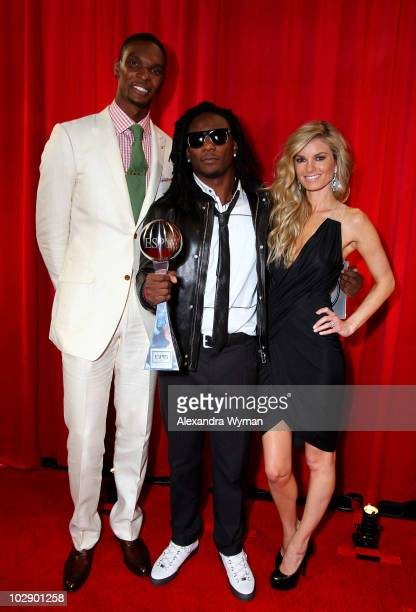NBA player Chris Bosh NFL player Chris Johnson of the Tennessee Titans with his Best Breakthrough Athlete Award and Marisa Miller pose backstage at...