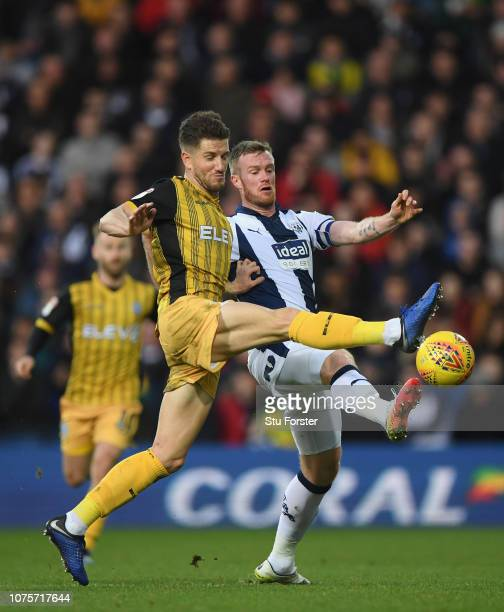 WBA player Chris Brunt is challenged by Sam Hutchinson of Sheff Wednesday during the Sky Bet Championship match between West Bromwich Albion and...