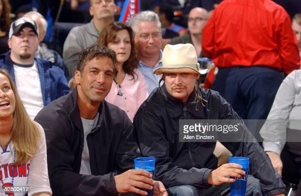 NHL player Chris Chelios and musician Kid Rock watch as the Detroit Pistons take on the Indiana Pacers in Game two of the Eastern Conference...