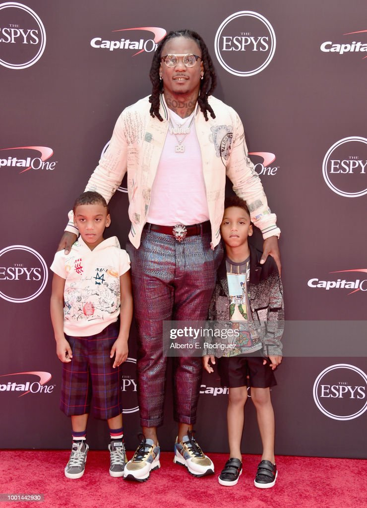 NFL player Chris Johnson (C) attends The 2018 ESPYS at Microsoft Theater on July 18, 2018 in Los Angeles, California.