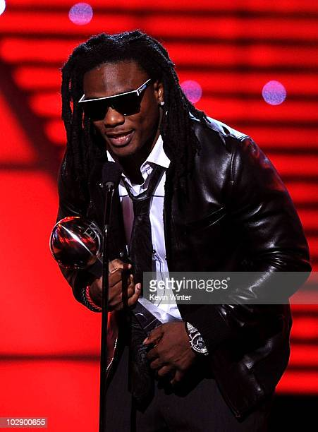 NFL player Chris Johnson of the Tennessee Titans accepts the Best Breakthrough Athlete Award onstage during the 2010 ESPY Awards at Nokia Theatre LA...