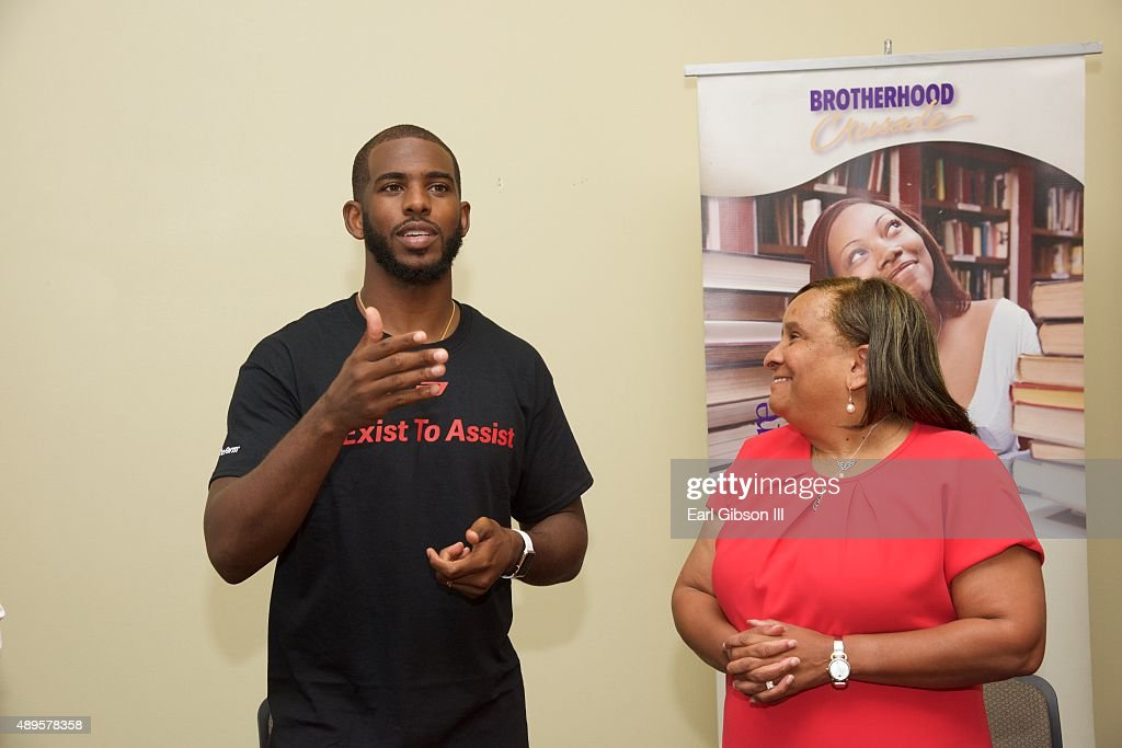 NBA Player Chris Paul and President/CEO of Brotherhood Crusade Charisse Bremond Weaver attend the Chris Paul Family Foundation's 'Exist to Assist' Community Program Launch at Brotherhood Crusade on September 22, 2015 in Los Angeles, California.
