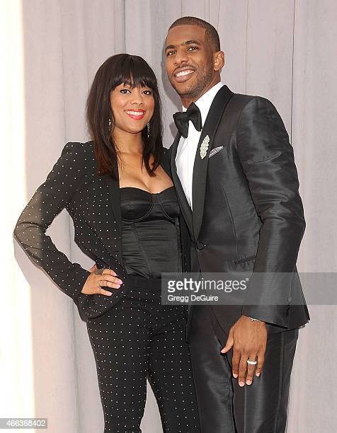 NBA player Chris Paul and wife Jada Crawley arrive at the Comedy Central Roast of Justin Bieber on March 14 2015 in Los Angeles California
