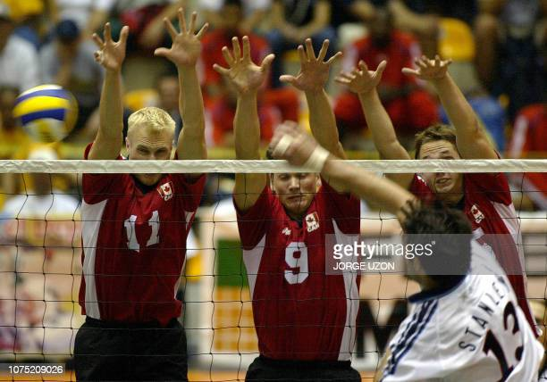 US player Clayton Stanley play with Canadian player's Steve Brinkman Paul Duerden and Fred Winters during the Male Volleyball Championship NORCECA...