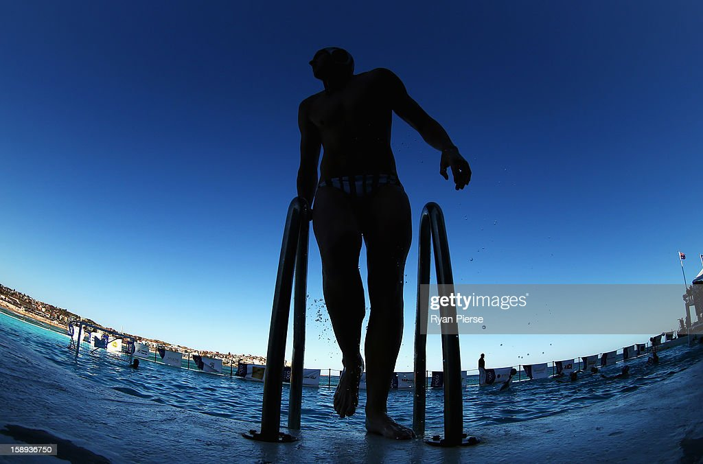 A player climbs out of the pool during the Water Polo by the Sea match between Sydney University Lions and UNSW Wests at Bondi Icebergs, Bondi Beach on January 4, 2013 in Sydney, Australia.