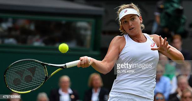 US player Coco Vandeweghe returns to ball to Russia's Maria Sharapova during their women's quarterfinals match on day eight of the 2015 Wimbledon...