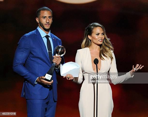 NFL player Colin Kaepernick and model Chrissy Teigen speak onstage at the 2014 ESPY Awards at Nokia Theatre LA Live on July 16 2014 in Los Angeles...