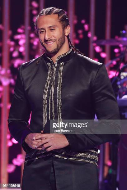 NFL player Colin Kaepernick speaks onstage during VH1's 3rd Annual 'Dear Mama A Love Letter To Moms' Inside Show at The Theatre at Ace Hotel on May 3...