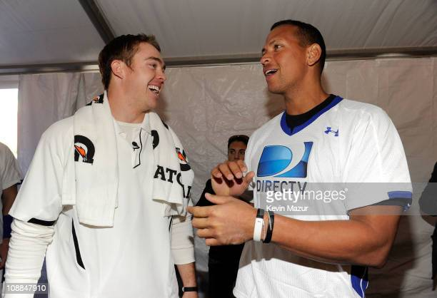 Player Colt McCoy of the Cleveland Browns and MLB player Alex Rodriguez of the New York Yankees pose during DIRECTV's Fifth Annual Celebrity Beach...