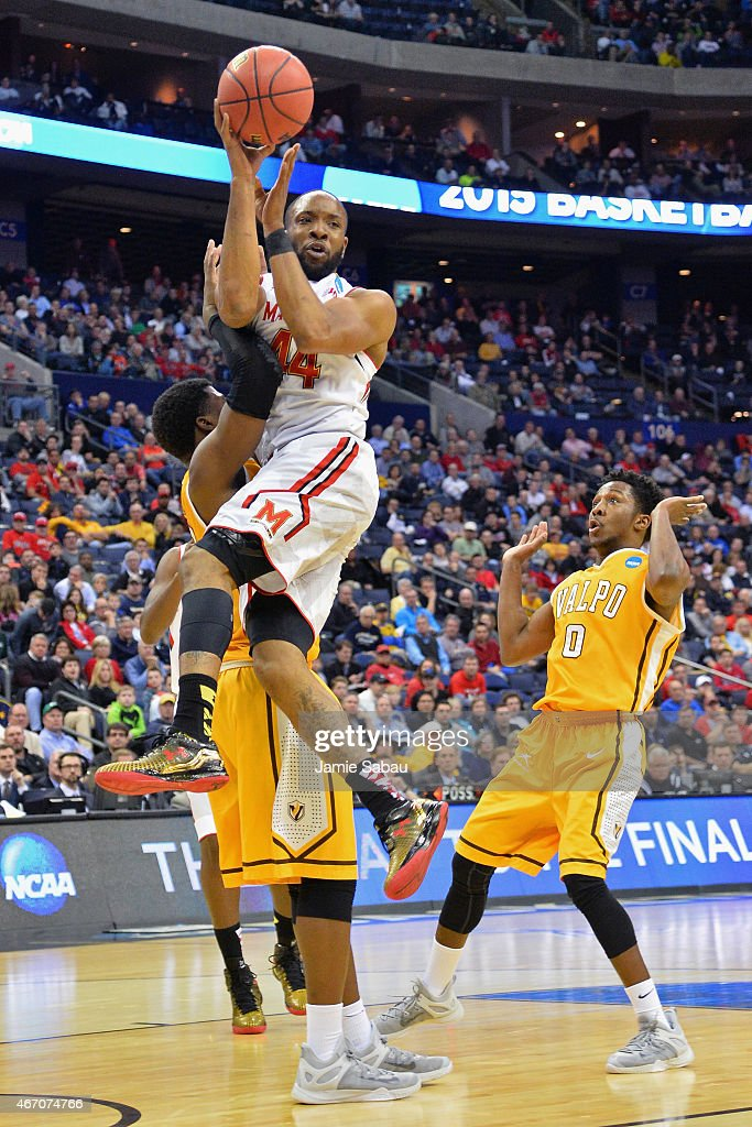 A player control foul is called after Dez Wells #44 of the Maryland Terrapins collides with Jubril Adekoya #23 of the Valparaiso Crusaders during the second round of the Men's NCAA Basketball Tournament at Nationwide Arena on March 20, 2015 in Columbus, Ohio.