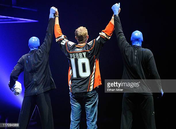 NHL player Corey Perry of the Anaheim Ducks appears onstage with Blue Man Group at The Venetian June 21 2011 in Las Vegas Nevada