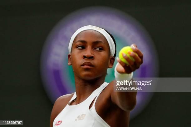 US player Cori Gauff serves against Slovakia's Magdalena Rybarikova during their women's singles second round match on the third day of the 2019...
