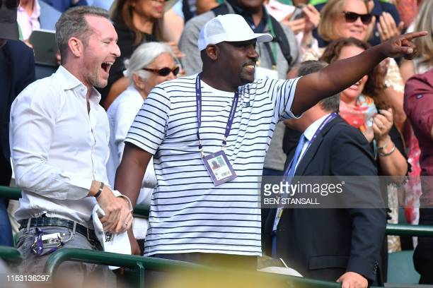 US player Cori Gauff's father Corey Gauff celebrates his daughter's win against US player Venus Williams during their women's singles first round...