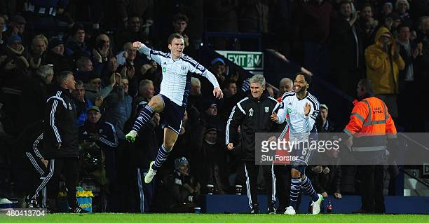 WBA player Craig Gardner celebrates his goal with manager Alan Irvine and Joleon Lescott during the Barclays Premier League match between West...