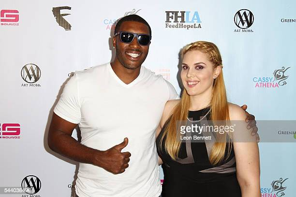 NBA player Craig Smith and Photographer Cassy Athena attends the EMotion Art Show on June 30 2016 in Los Angeles California