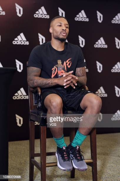 NBA player Damian Lillard of the Portland Trail Blazers speaks at an Adidas press conference during his China tour on September 11 2018 in Beijing...
