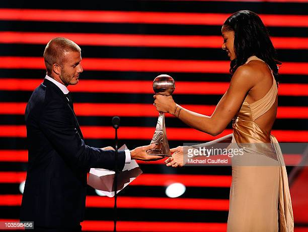 MLS player David Beckham presents WNBA player Candace Parker the 'Best Female Athlete' award onstage at the 2008 ESPY Awards held at NOKIA Theatre LA...