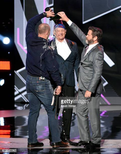 MLB player David Ross actors Bill Murray and Nick Offerman accept the Best Moment award on behalf of the 2016 World Series champion Chicago Cubs...