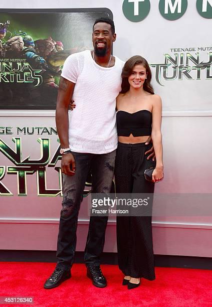 NBA player DeAndre Jordan and model Amber Alvarez attend Paramount Pictures' 'Teenage Mutant Ninja Turtles' premiere at Regency Village Theatre on...