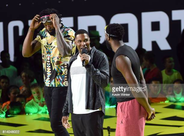 NBA player DeAndre Jordan TV personality Michael Strahan and NBA player Andre Drummond speak onstage during Nickelodeon Kids' Choice Sports Awards...