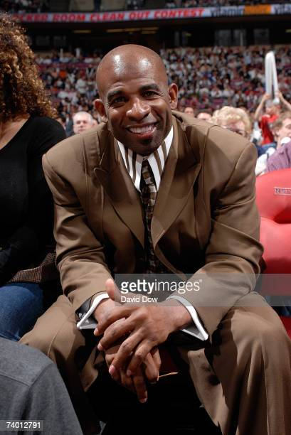 NFL player Deion Sanders watches the game between the New Jersey Nets and the Toronto Raptors Game Three of the Eastern Conference Quarterfinals...