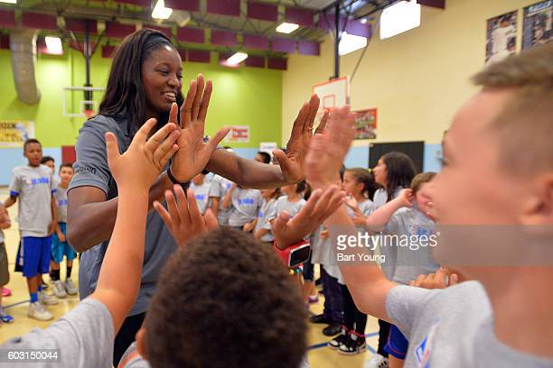 WNBA player Delisha MiltonJones participates in the NBA JR FIT Clinic Presented by Spalding on September 7 2016 at the Boys and Girls Club in...
