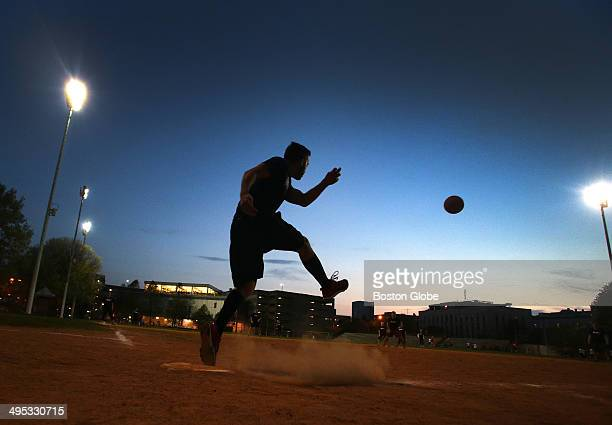 A player delivers a kick during a game at Carter playground in the South End between Ernest Plays Kickball and Black Magic
