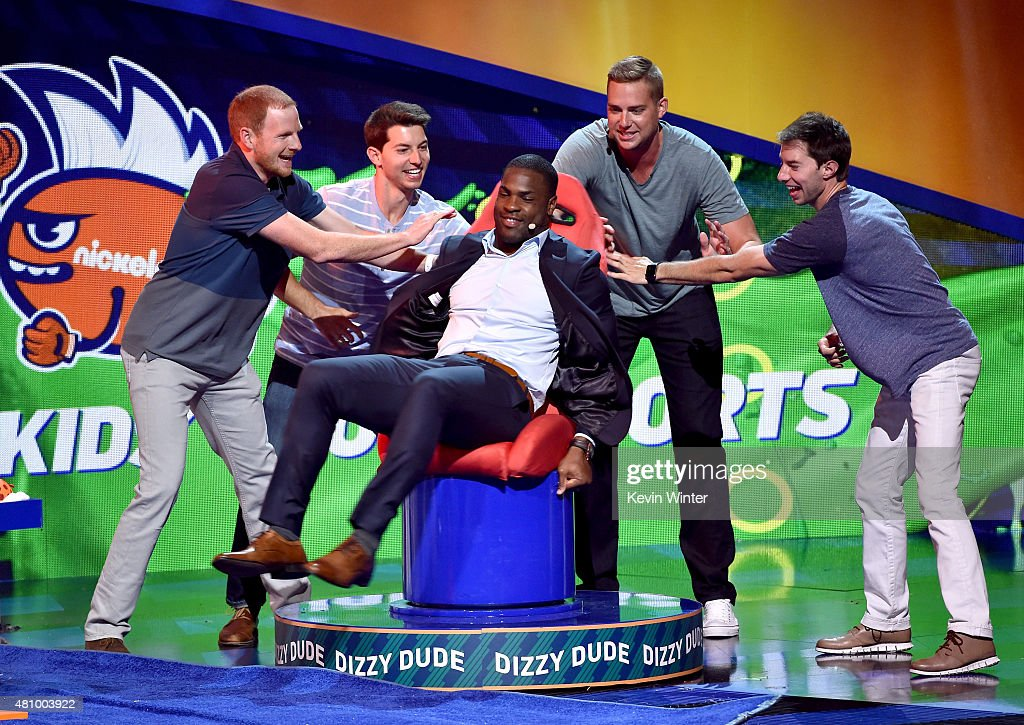 NFL player DeMarco Murray (C) rides the Dizzy Dude with members of Dude Perfect at the Nickelodeon Kids' Choice Sports Awards 2015 at UCLA's Pauley Pavilion on July 16, 2015 in Westwood, California.