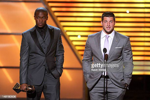 Player Demaryius Thomas and Tim Tebow of the Denver Broncos accept the Best Moment award onstage during the 2012 ESPY Awards at Nokia Theatre L.A....