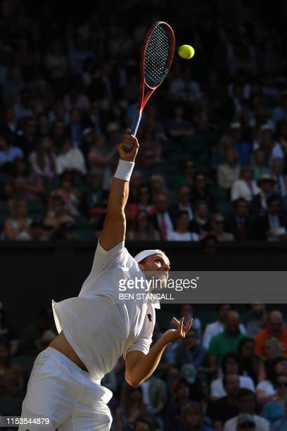 US player Denis Kudla serves against Serbia's Novak Djokovic during their men's singles second round match on the third day of the 2019 Wimbledon...
