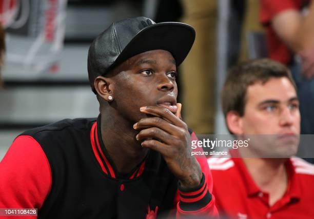 NBAplayer Dennis Schroeder of the Atlanta Hawks watches the German Bundesliga basketball playoff final between Brose Baskets Bamberg and Bayern...