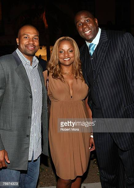 Player Derrick Fisher wife Candice Fisher and former NBA player Magic Johnson inside at the LA Stars Celebrity All Star Charity Weekend Rodeo Drive...